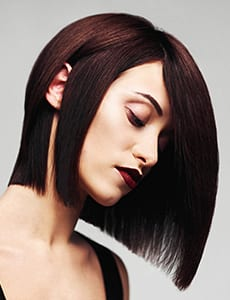 Model with perfect long glossy brown hair. Close-up Bob haircut portrait