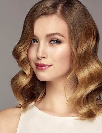 Hair color of straw, middle length hairstyle, soft, almost invisible makeup. Beauty portrait of young, gorgeous woman. Natural gloss of healthy hair. Hair care and hairdressing art.